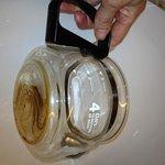 bathroom coffee pot, with dried coffee inside