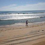 Walking on beach, across the street from hotel