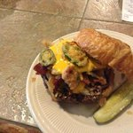 How 'bout a burger on a croissant, topped with bacon, hash browns, cheese sauce, grilled onions