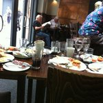 this is just one of many tables that were stacked high with plates,tables dirty and short staffe