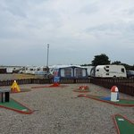 crazy golf looking onto tourers and behind campsite