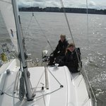 Happy level 2 sailors in charge of the boat