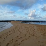 Poipu Beach at low tide; at high tide waves come in from both directions...so fun!