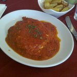 Chicken in a tomato, garlic and chilli sauce with chips