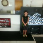 my son in the lobby with the wing he got from kyle larson