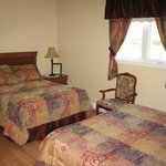 One of our double rooms ( Queen & double bed)