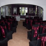 function room set for wedding ceremony