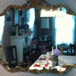 View through ornate dining room mirror