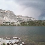 A rainstorm threatens the skies over Lake Marie and the Snowy Range