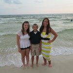 Kids in front of the emerald coast waters.