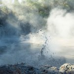 Boiling mud, light, and steam at Wai-0-Tapu