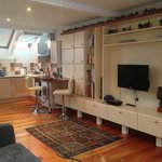 Long view of living/dinette/kitchen studio area