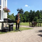A saxophonist entertained us in the sun