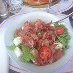 Salad with ham and buffalo mozarella.