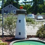 A miniature lighthouse, located at the eighteenth hole.
