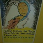 Cute poster in the bathroom.