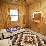 Cozy cabins sleep six with two bedrooms and a fold out couch.
