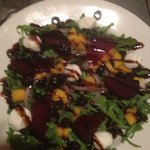 Baby arugula with goat cheese, oven roasted red beets, mango, olives and red onions. Drizzled wi