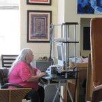JamesBen at his desk among all the art