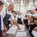 Executive Chef Colin Bedford and team planning in kitchen