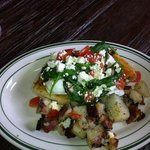 Morning Saute... fresh biscuit covered by pouched eggs, spinach, mushrooms, and tomatoes. feta a