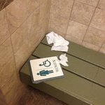 Trash in public bath that was uidentifiable from the pool entrance since plaquard was laying in