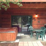 View of our patio and entrance to our unit. The hot tub and grill worked fine