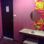 The bathroom door and the make up table.