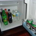 Drinks stocked daily in room fridge