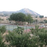 View of tennis court/mountains