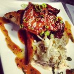 Braised Carolina style short rib barbecue on garlic toast with a side of spicy slaw