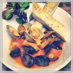 Mussels, clams, and chorizo in a yellow curry broth