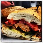 Grilled chorizo, avocado, fresh fennel, tomato, and fennel mayo on a baguette