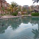 Resort reflected in swimming pool