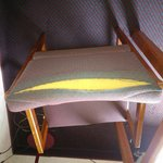 Other torn chair in room