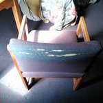 Torn chair in room
