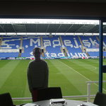 Inside a private box overlooking the pitch