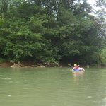 Floating on the Baru River - helmuts were necessary for going through the level one rapids.