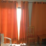 Brown walls,Orange Curtains and Pine