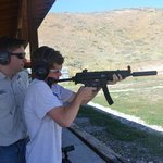 14 yr old getting instruction on his favorite gun