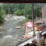 From inside looking out and down to outdoor riverside tables