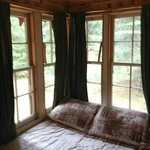 Here's the bed.  Sticks holding the windows up.  More peeling paint.