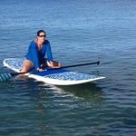 Elise taking a break from paddle surfing