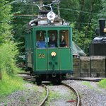 100-year-old Berne tramcar squeals into the museum site past  German Mallet loco for the weekend