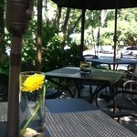 lovely patio seating beside a park, the canal, and historic meridian street