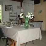 Main room of the farmhouse set for dinner