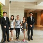 With hotel staff