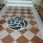 Marble mosaic floor in front hall