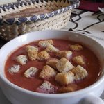 """Cold cherry """"gazpacho"""" with cubes of fresh cheese and crotons"""