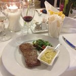 Steak Minute. Grilled sirloin steak served with home made bearnaise sauce,  french fries, tomato